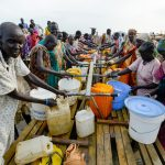 On 18 May, women fill jerrycans, buckets and other plastic containers at a UNICEF-provided water point in the Bentiu Protection of Civilians site for internally displaced people, in Unity State.  By 21 May 2015 in South Sudan, the situation had drastically deteriorated in the preceding two weeks, with heavy fighting ongoing across Unity and Upper Nile States. Some 100,000 people have been internally displaced and 650,000 cut off from aid as humanitarian organizations have been forced to withdraw from affected areas. The violence in the two states has led to a spike in reports of grave child rights violations. Between 13 and 15 May 2015, UNICEF collected testimonies from survivors and witnesses of attacks that took place throughout Rubkona and Guit Counties in Unity State in early May 2015. The testimonies were provided by new arrivals at the Bentiu Protection of Civilians (PoC) site for internally displaced people (IDPs), in Unity State. A total of 41 incidents were recorded, 33 of which are verified. These include 47 children killed, at least 23 children raped and 26 abducted. There are also reports of large-scale recruitment of children. The high numbers of IDPs make it difficult to maintain standards for water, sanitation and hygiene (WASH) services in the Bentiu PoC, where the water supply has fallen from over 15 litres per person per day to 9 litres, and there is only one latrine for every 65 persons. Additionally, several water samples from a new borehole show poor water clarity, meaning water will have to be treated before distribution in order to meet standards in water quality. In the camp, UNICEF is constructing 682 latrines, of which 304 are already complete; supporting partners to provide primary health care; providing measles and polio vaccinations for children under age 15, particularly new arrivals; constructing temporary learning spaces; and, between 8 and 21 May, screened a total of 9,288 children under age 5 for malnutrition. In the past two week