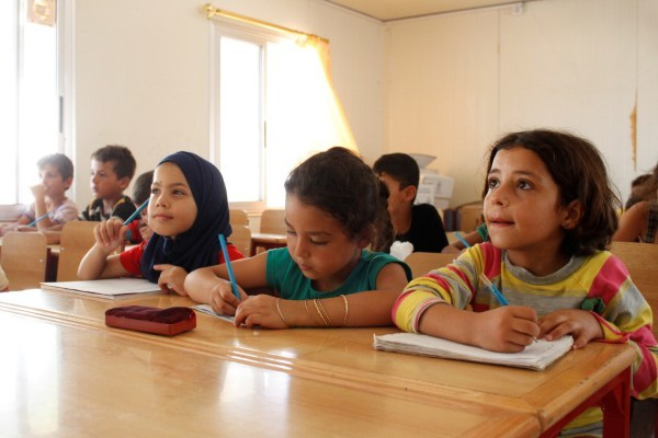 "On March 6 2016 in the Syrian Arab Republic, a fourth grade class studies in a classroom in the Al Karnak camp in the city of Tartous.  14 March 2016 - An estimated 3.7 million Syrian children – 1 in 3 of all Syrian children - have been born since the conflict began five years ago, their lives shaped by violence, fear and displacement, according to a UNICEF report. This figure includes 306,000 children born as refugees since 2011. In total, UNICEF estimates that some 8.4 million children - more than 80 per cent of Syria's child population - are now affected by the conflict, either inside the country or as refugees in neighbouring countries. ""In Syria, violence has become commonplace, reaching homes, schools, hospitals, clinics, parks, playgrounds and places of worship,"" said Dr. Peter Salama, UNICEF's Regional Director for the Middle East and North Africa. ""Nearly 7 million children live in poverty, making their childhood one of loss and deprivation.""   According to ""No Place for Children"", UNICEF verified nearly 1,500 grave violations against children in 2015. More than 60 per cent of these violations were instances of killing and maiming as a result of explosive weapons used in populated areas. More than one-third of these children were killed while in school or on their way to or from school. In Syria's neighbouring countries, the number of refugees is nearly 10 times higher today than in 2012. Half of all refugees are children. More than 15,000 unaccompanied and separated children have crossed Syria's borders. ""Five years into the war, millions of children have grown up too fast and way ahead of their time,"" Salama said. ""As the war continues, children are fighting an adult war, they are continuing to drop out of school, and many are forced into labour, while girls are marrying early.""   In the earlier years of the conflict, most of the children recruited by armed forces and groups were boys between 15 and 17 years old, and they w"