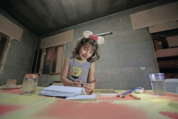 "On 19 September 2015 in the Syrian Arab Republic, Nuha, 11, prepares to go back to school in Homs.  14 March 2016 - An estimated 3.7 million Syrian children – 1 in 3 of all Syrian children - have been born since the conflict began five years ago, their lives shaped by violence, fear and displacement, according to a UNICEF report. This figure includes 306,000 children born as refugees since 2011. In total, UNICEF estimates that some 8.4 million children - more than 80 per cent of Syria's child population - are now affected by the conflict, either inside the country or as refugees in neighbouring countries. ""In Syria, violence has become commonplace, reaching homes, schools, hospitals, clinics, parks, playgrounds and places of worship,"" said Dr. Peter Salama, UNICEF's Regional Director for the Middle East and North Africa. ""Nearly 7 million children live in poverty, making their childhood one of loss and deprivation.""   According to ""No Place for Children"", UNICEF verified nearly 1,500 grave violations against children in 2015. More than 60 per cent of these violations were instances of killing and maiming as a result of explosive weapons used in populated areas. More than one-third of these children were killed while in school or on their way to or from school. In Syria's neighbouring countries, the number of refugees is nearly 10 times higher today than in 2012. Half of all refugees are children. More than 15,000 unaccompanied and separated children have crossed Syria's borders. ""Five years into the war, millions of children have grown up too fast and way ahead of their time,"" Salama said. ""As the war continues, children are fighting an adult war, they are continuing to drop out of school, and many are forced into labour, while girls are marrying early.""   In the earlier years of the conflict, most of the children recruited by armed forces and groups were boys between 15 and 17 years old, and they were used primarily in support roles"