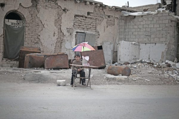 "On 29 October 2015 in East Ghouta, rural Damascus, an internally displaced boy sits with items he will sell.  14 March 2016 - An estimated 3.7 million Syrian children – 1 in 3 of all Syrian children - have been born since the conflict began five years ago, their lives shaped by violence, fear and displacement, according to a UNICEF report. This figure includes 306,000 children born as refugees since 2011. In total, UNICEF estimates that some 8.4 million children - more than 80 per cent of Syria's child population - are now affected by the conflict, either inside the country or as refugees in neighbouring countries. ""In Syria, violence has become commonplace, reaching homes, schools, hospitals, clinics, parks, playgrounds and places of worship,"" said Dr. Peter Salama, UNICEF's Regional Director for the Middle East and North Africa. ""Nearly 7 million children live in poverty, making their childhood one of loss and deprivation.""   According to ""No Place for Children"", UNICEF verified nearly 1,500 grave violations against children in 2015. More than 60 per cent of these violations were instances of killing and maiming as a result of explosive weapons used in populated areas. More than one-third of these children were killed while in school or on their way to or from school. In Syria's neighbouring countries, the number of refugees is nearly 10 times higher today than in 2012. Half of all refugees are children. More than 15,000 unaccompanied and separated children have crossed Syria's borders. ""Five years into the war, millions of children have grown up too fast and way ahead of their time,"" Salama said. ""As the war continues, children are fighting an adult war, they are continuing to drop out of school, and many are forced into labour, while girls are marrying early.""   In the earlier years of the conflict, most of the children recruited by armed forces and groups were boys between 15 and 17 years old, and they were used primarily in supp"