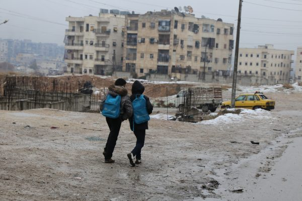 On 5 January, two boys head home after school in East Aleppo in a snow day for the city. Following almost five years of the Syria crisis, 4.5 million people continue to live in areas – like this one-that are hard to reach for the humanitarian community. A very harsh weather conditions are amongst many difficulties that civilians have to endure to survive in the northern parts of Syria.   UNICEF is targeting one million children throughout the country with winter supplies during the 2015/2016 winter season.   So far, winter clothing kits and blankets have reached 95,000 children while delivery and distribution is ongoing for 545,000 children.  In addition, 2,000 heaters are currently being installed in classrooms benefiting 80,000 children.
