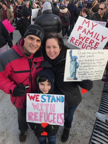 Sara Green with her husband and son, Dylan, at a New York protest.